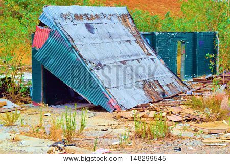 Dilapidated shack with a collapsing roof which was once a working barn
