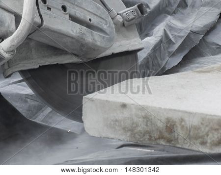 Stone sawing with a circular saw while renovation of a town