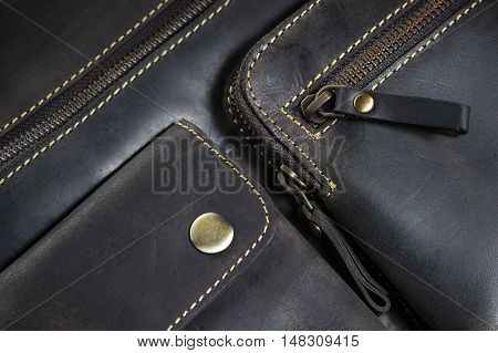 Leather bag with zipper, magnetic clasp on pocket and stitches, men's accessories in vintage style, macro shot, selective focus