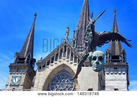 Basilica and Bolivar Condor statue in Manizales Colombia