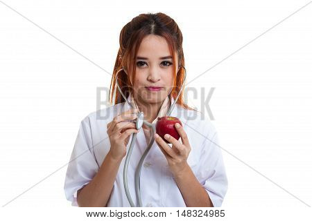 Young Asian Female Doctor Listening To An Apple With A Stethoscope.