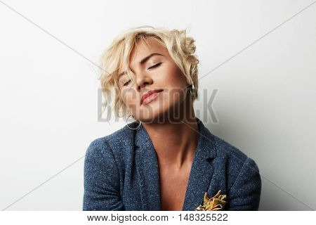 Portrait Handsome Young Woman Blonde Hair Wearing Blue Jacket Empty White Background.Beauty Fashion People Photo.Pretty Girl Smiling Camera Closed Eyes Studio Shot.Horizontal Image