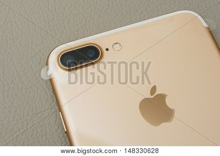PARIS FRANCE - SEP 16 2016: PARIS FRANCE - SEP 16 2016: New Apple iPhone 7 Plus unboxed in the first day of sales. two camera lenses and plastic film on phone. New Apple iPhone acclaims to become the most popular smart phone in the world in 2016