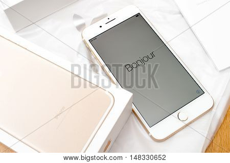 PARIS FRANCE - SEP 16 2016: New Apple iPhone 7 Plus unboxed in the first day of sales - Bonjour text on first run. New Apple iPhone claims to become the most popular smart phone in the world in 2016