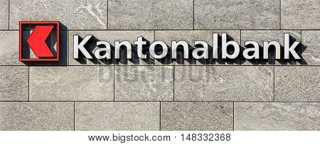 Einsiedeln, Switzerland - 7 September, 2015: sign on the wall of a Cantonal Bank of Schwyz (German: Schwyzer Kantonalbank) office. Cantonal banks are Swiss state-owned commercial banks.