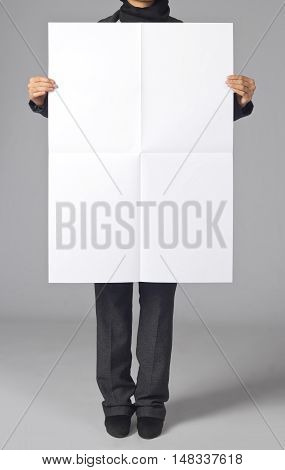 Woman holding a blank poster. Branding, brand, template, identity, design, business, envelope, print, mock-up, mock up, mockup.