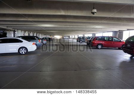JOLIET, ILLINOIS / UNITED STATES - SEPTEMBER 4, 2016: Vehicles are parked in the parking garage of the Presence Saint Joseph Medical Center in Joliet.