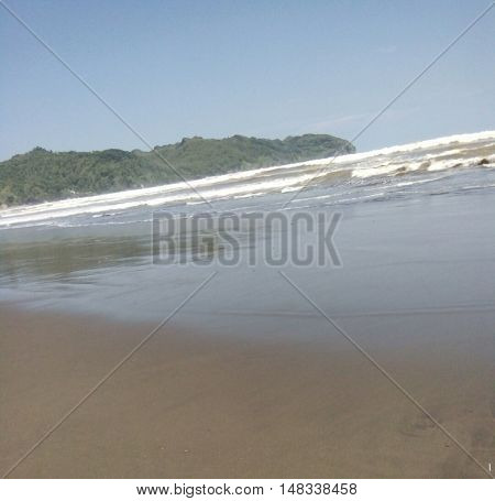 Fiew waves of jetis beach at kebumen indonesia