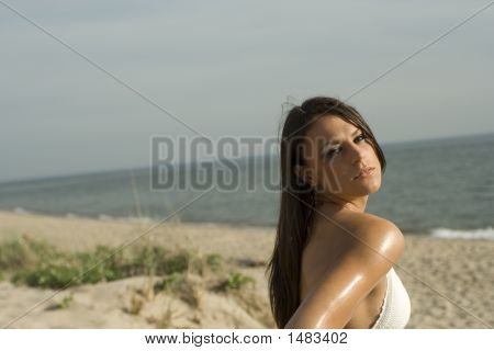 Woman In Bikini On The Beach Looking Over Her Shoulder