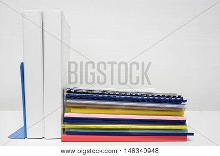 Stack of folder and report on the desk in office