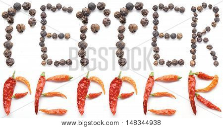 Compilation of peppercorns and dried cayenne peppers spelling out the word