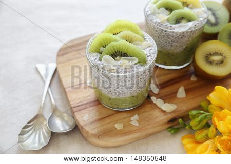 Homemade Chia pudding with kiwi and almond slices