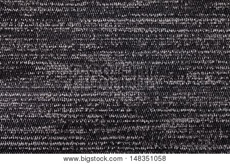 Black and white background from a soft textile material. sheathing fabric with natural texture. Cloth backdrop.