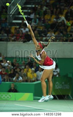 RIO DE JANEIRO, BRAZIL - AUGUST 13, 2016: Olympic champion Monica Puig of Puerto Rico in action during tennis women's singles final of the Rio 2016 Olympic Games at the Olympic Tennis Centre