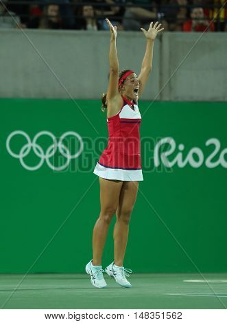 RIO DE JANEIRO, BRAZIL - AUGUST 13, 2016: Olympic champion Monica Puig of Puerto Rico celebrates victory after tennis women's singles final of the Rio 2016 Olympic Games at the Olympic Tennis Centre