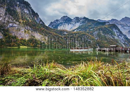 Berchtesgaden in Germany on the border with Austria. Famous lake Konigssee. Pier for tourist pleasure boats. The concept of active tourism and ecotourism