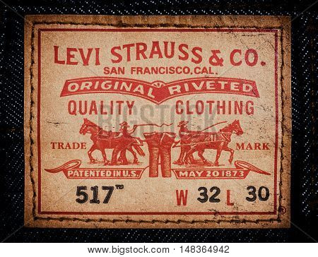 Estonia, Tallinn, December 21, 2015. Levis jeans label. Selective focus. Retro style toned image