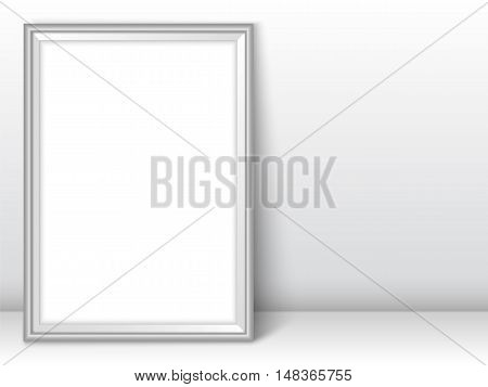 Photoframe template. Silver picture framing mockup. Frame near the wall on the floor with realistic shadows. Vector template for presentation your photo art or other crafts.