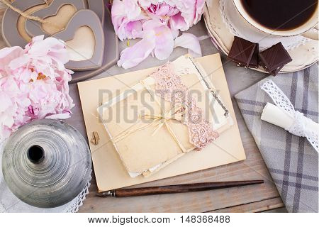 Nostalgic Retro Background of Old Letters Post Cards Peony Flowers Coffe and Chocolates