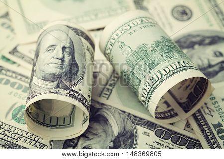 Heap of cash US dollar bills background, closeup.