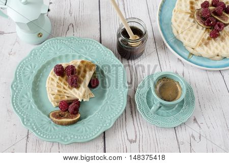 Soft Belgian Heart Shaped Waffles With Raspberries And Figs, Covered With Honey On Turquoise Blue Pl