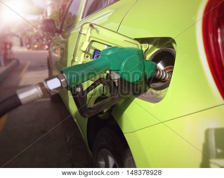 Fill the machine with fuel or car refueling at petrol station (Selective focus)