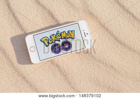 JURMALA LATVIA - July 13 2016: Pokemon Go logo on the smartphone. Pokemon Go is a location-based augmented reality mobile game.