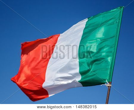 Waving Flag Of Italy, Europe, Italian Republic. Italian Flag Blowing In The Wind. Italy Flag Of Silk On Blue Sky Background. Italian National Day