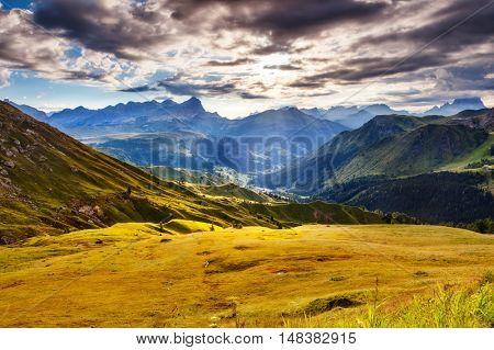 Great view of the Val di Fassa valley. National Park Dolomites (Dolomiti), Pordoi pass. Location Livinallongo del Col di Lana, province Belluno, Veneto, Tyrol, Italy alps, Europe. Beauty world.
