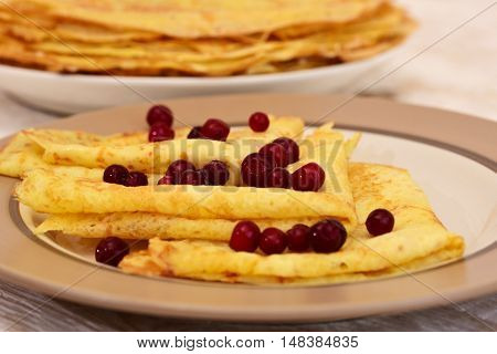 Delicious crepes with berry. Traditional crepes close-up.