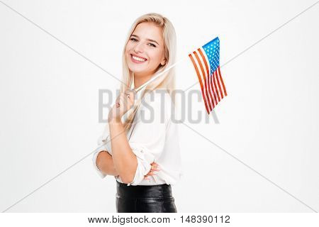 Portrait of happy young businesswoman with flag of America over white background