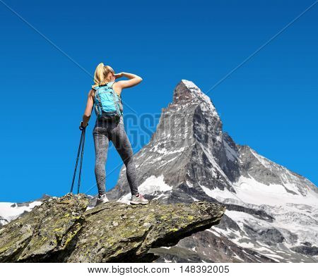 Girl on the top, in the background mountain Matterhorn - Pennine Alps, Switzerland