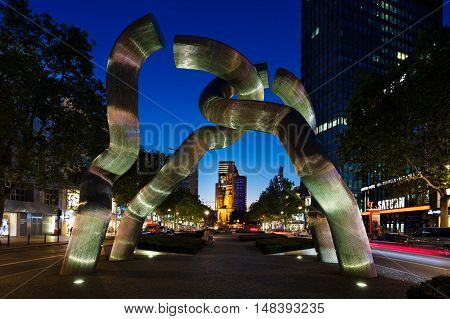 Berlin Germany August 26 2016: The Broken Chain Sculpture on Tauentzienstrasse at night time. The monument was installed in 1987 by Brigitte Matschinsky-Denninghof and Martin Matschinsky