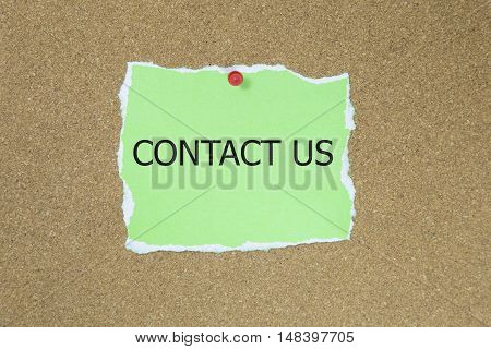 contact us in text on a sticky note posted to a cork notice board.