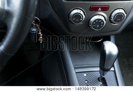 Car inside whit automatic transmission whit climate control and air conditioning close selective focus