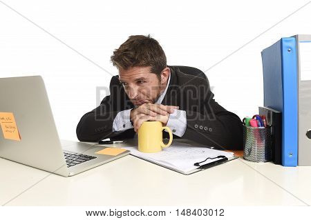 tired and frustrated businessman desperate face expression suffering stress looking worried at office computer desk busy with paperwork file overwhelmed and stressed isolated on white background