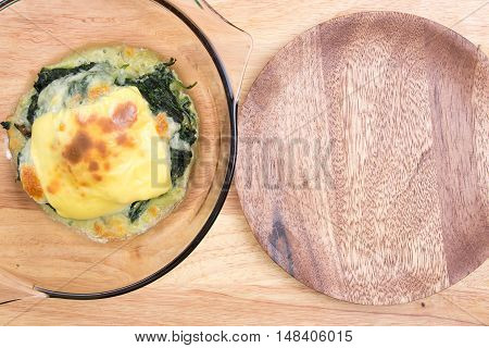 Baked spinach in bowl / cooking Baked spinach concept