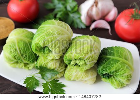 Cabbage stuffed with rice and meat on plate.