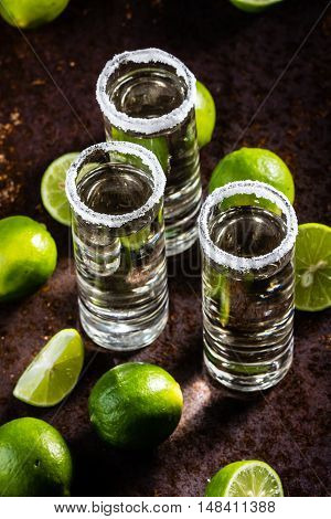 Mexican tequila. Tequila shot with lemon lime and sea salt. selective focus