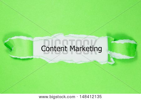 The text Content Marketing appearing behind torn paper.