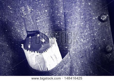 bottle of hard liquor in the pocket of jacket