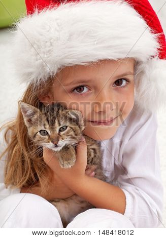 The best christmas present - little girl with her new kitten