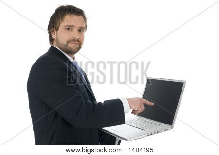 Young Businessman In A Suit Holding A Notebook