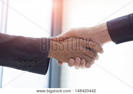 Businessmen handshake and business people ; success dealing greeting & business partner concepts - vintage toneRetro filter effect.