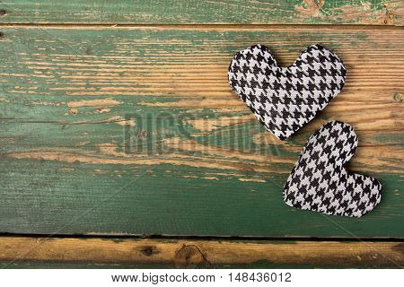 houndstooth hearts on a green background, copy space