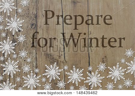 Prepare for Winter Message White Snowflakes on Weathered Wood Background and text Prepare for Winter