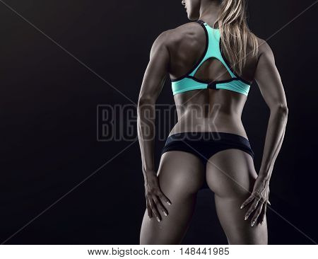 Nice sexy woman with great buttock over black background