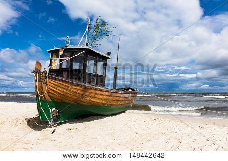 A fishing boat on shore of the Baltic Sea in Ahlbeck (Germany).