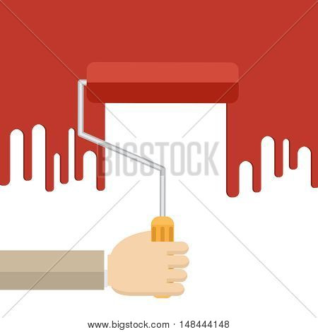 Hand with red roller painting the white wall.