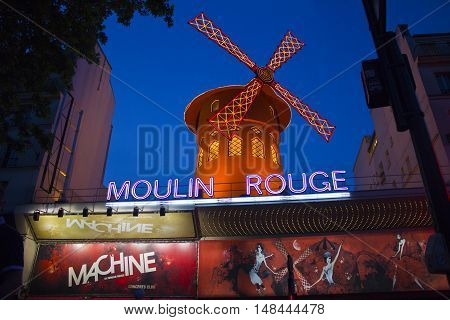 Paris - Circa May 2011: The Moulin Rouge at dusk. The Moulin Rouge is a cabaret in Paris France I